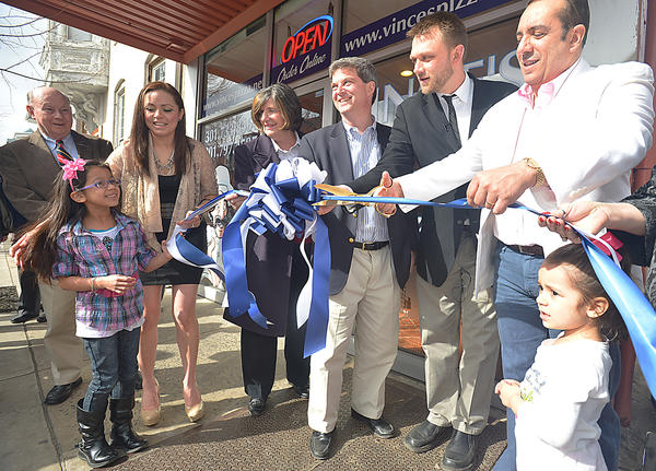 Vince's Pizza Express ribbon- cutting ceremony Wednesday. From left, Don Munson, Mia Gonzalez, Glenda Gonzalez, Juliana Albowicz, Brien Poffenberger, David Gysberts, owner Roberto Gonzalez, and Bianca Gonzalez.