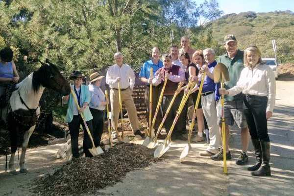 Officials, residents and members of the Trails Council pose at the groundbreaking of the Ultimate Destination Point project.