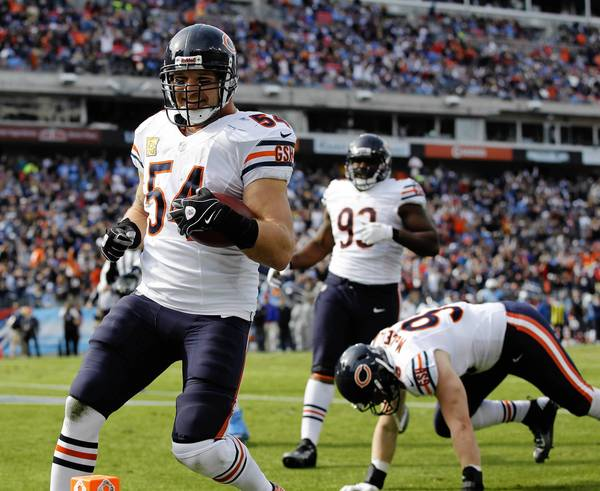 Chicago Bears middle linebacker Brian Urlacher returns an interception for a touchdown against the Tennessee Titans in the first quarter at LP Field.