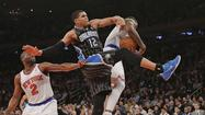 New York Knicks J.R. Smith pulls in rebound from Orlando Magic Tobias Harris in NBA game in New York