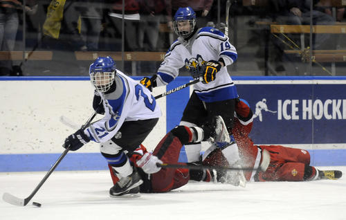 Alex Manner of East Catholic comes up with the puck against Fairfield Warde during the first period of the high school Division II hockey final at Ingalls Rink at Yale in New Haven Wednesday night. Manner score one of three goals for the Eagles but it wasn't enough in a 4-3 loss in overtime.
