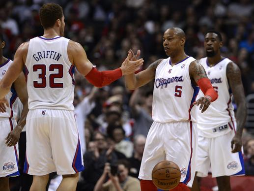 Clippes power forward Blake Griffin congratulates forward Caron Butler after he scored against the 76ers in a 101-72 victory on Wednesday night at Staples Center.