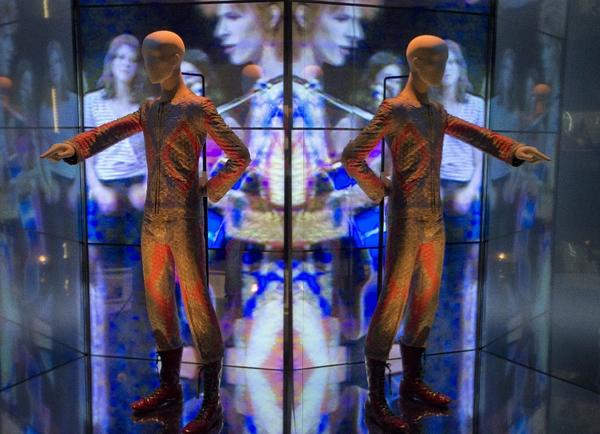 "A reflection of the costume that David Bowie wore as Ziggy Stardust photographed as part of a retrospective exhibition titled ""David Bowie Is,"" at the V&A Museum in London."