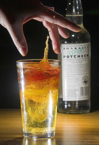 Potcheen is added to make the Raging Irishman at Blarney Stone Pub.