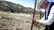 ARIVACA, Ariz. — When Jim Chilton tends to the cattle on his 50,000-acre ranch in southern Arizona, he packs at least two guns and no less than 5 gallons of water.