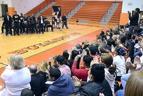 The crowd cheers for the members of the Martinsburg boys basketball team during a celebration of the Bulldogs' championship season Wednesday evening at Martinsburg High School. The Bulldogs defeated Beckley Woodrow Wilson 57-52 for the West Virginia Class AAA state title on Saturday night in Charleston.