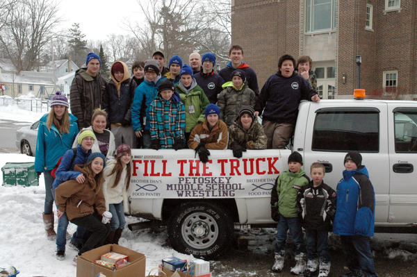 The Petoskey Middle School wrestling team came together Wednesday with Brother Dans Food Pantry of Petoskey going door-to-door collecting non-perishable food for those in need. Members of the teams stat crew, parents and coaches also took part.