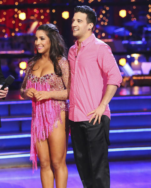 "Aly Raisman and pro partner Mark Ballas listen to the judges' comments during Week 1 of ""Dancing With the Stars."""