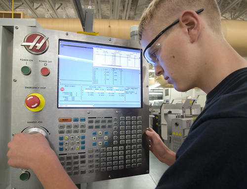 Brent Novitsky, 16, of Slatington, operates the keyboard as he simulates how to change tool holders in a computer driven vertical milling machine in the Precision Machine Tool Technology Lab at Lehigh Career and Technical Institute in Schnecksville on Wednesday.