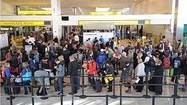 Frustrated travelers reported long lines at Baltimore-Washington International Thurgood Marshall Airport on Friday morning, as crowds jammed into terminals on their way out of town as local schools prepared to let out for spring break.