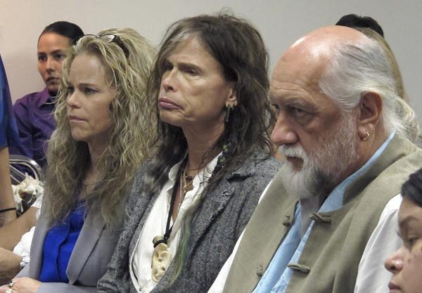 Aerosmith lead singer Steven Tyler, center, with his attorney Dina LaPolt, left, and Fleetwood Mac drummer Mick Fleetwood as they listen to testimony on a celebrity privacy bill during a hearing at the Hawaii Capitol in Honolulu.