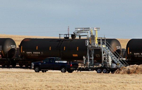 Rail cars are loaded with crude oil at the Casper Logistics Hub in Wyoming. Cheap oil moving by rail may help lower California gasoline prices.