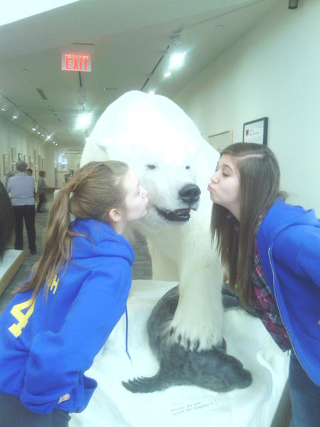 Alanson eighth-graders Brianna Thrush (left) and Alyssa King get up-close and personal with a stuffed polar bear at the Dennos Museum in Traverse City. Alanson middle-schoolers (grades six-eight) recently took a field trip to the museum to view the Inuit and Discovery exhibits and watch the performance of the one woman show, The Spirit of Harriet Tubman, by Leslie McCurdy..