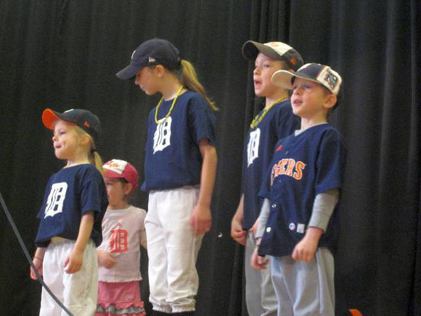 Sheridan Elementary students (from left) Kiley Bromley, Lyla Janes, Kalyn Bromley, Kenzie Bromley and Haden Janes sing and act out Take me out to the Ballgame during a talent show at the school..