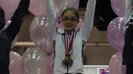 Grace Johnson of New Lenox came away from the Level 6 lllinois State Gymnastics meet with two State Champion titles. The three-day meet took place March 15-17 in St. Charles, IL.