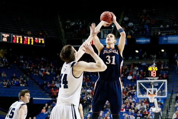 Mike Muscala of the Bucknell Bison shoots against Andrew Smith of the Butler Bulldogs in the first half.