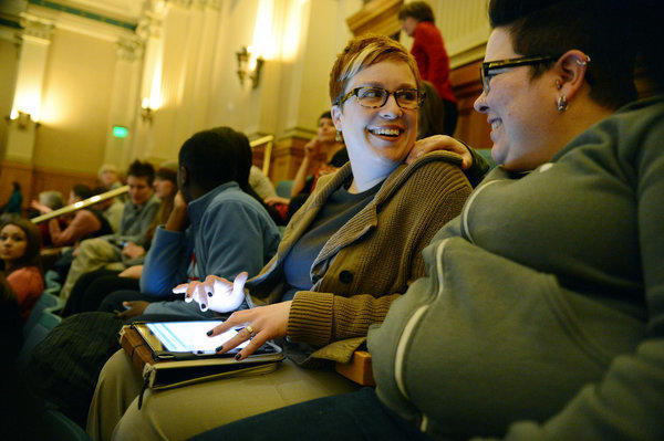 Stephanie Huston, left, and her partner, Robyn Henderson-Espinoza, wait for the vote on civil unions at the Colorado state Capitol in Denver this month. The bill is set to be signed into law Thursday.