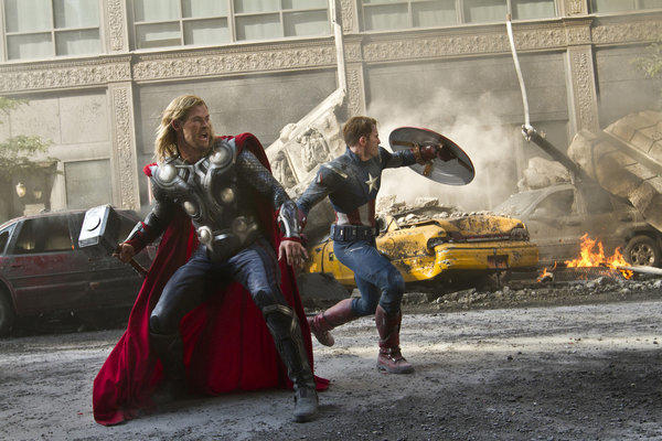 "Chris Hemsworth portrays Thor, left, and Chris Evans portrays Capt. America in a scene from ""The Avengers,"" one of the hit films of 2012."