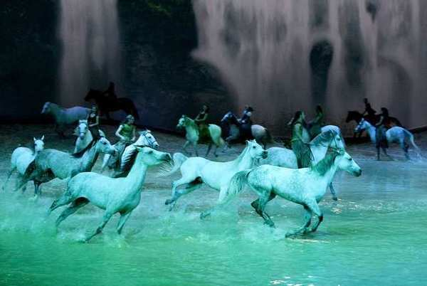 ARCHIVE PHOTO: White horses race around a large pool of water during the Cavalia Odysseo show in Burbank.