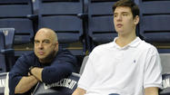 UConn junior forward Tyler Olander was arrested and charged with trespassing Thursday and spent some time in a Bay County, Fla., jail.