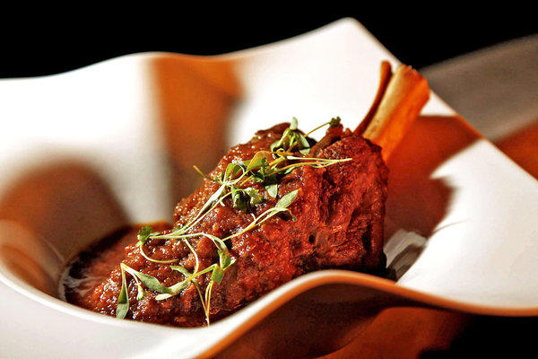 Lamb shank, slow-cooked with browned onion paste, ginger, tomato and freshly ground spices.