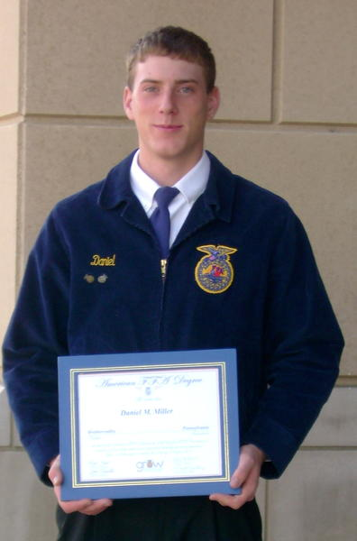 Dan Miller, 21, of Fairhope wants to stay in Somerset County and work in agriculture after graduating from Penn State University later this year. He is pictured here receiving his American Degree last fall in Indianpolis, Ind.