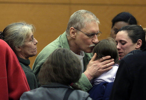 David Ranta kisses a family member after being freed in state Supreme Court in Brooklyn, New York. He spent more than two decades behind bars before a reinvestigation cast serious doubt on evidence used to convict him in the 1990 shooting of Rabbi Chaskel Werzberger.