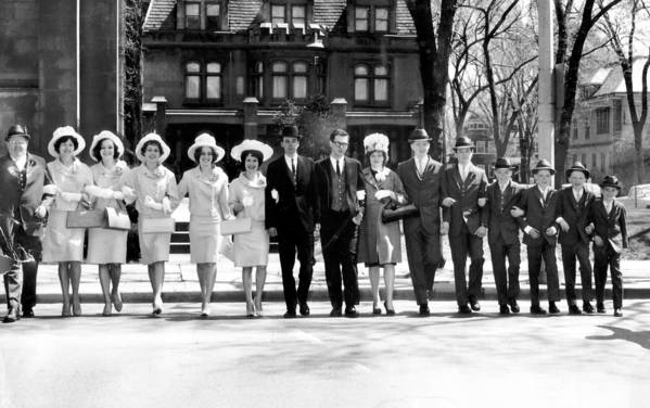 EASTER 1963. The Thomas Brennan family of 321 S. Euclid Avenue in Oak Park, Ill. after attending Easter services on April 14, 1963 at St. Edmund's Roman Catholic Church in Oak Park with their 11 children, two of whom are married. From left are, Thomas and Theresa Brennan, Brigid, 22, Aine, 23, Margaret, 19, Mrs. Rosaleen Langtry, 21, her husband Richard Langtry, Michael Ulbert, his wife Mrs. Kathleen Ulbert, 20, Thomas Jr., 17, Patrick, 15, Michael, 14, Brian, 12, Sean, 11, and Seamus 10.