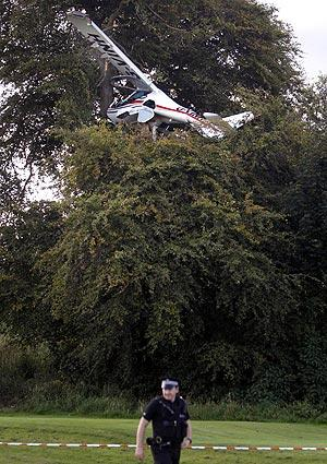 That's some birdie! A plane rests atop a tree at the 15th hole of Caird Park Golf Course in Dundee, Scotland. The pilot was rescued after being trapped for about an hour. He suffered a head injury but was able to talk to emergency workers.