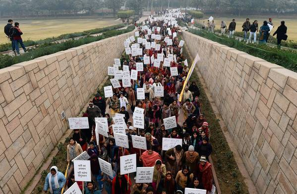 Indian women hold a protest in New Delhi after the fatal gang rape of a student there in December.
