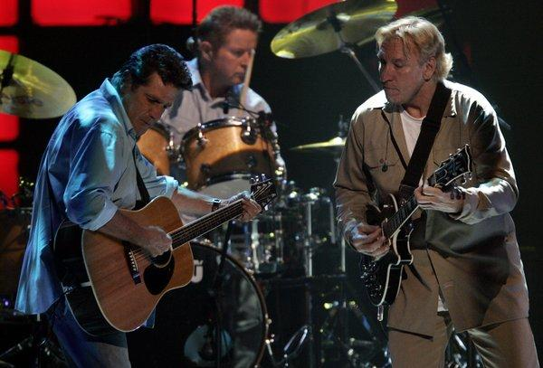 Glenn Frey, left, Don Henley and Joe Walsh of the Eagles, shown during a 2005 concert in Anaheim, will mount a summer tour this year.