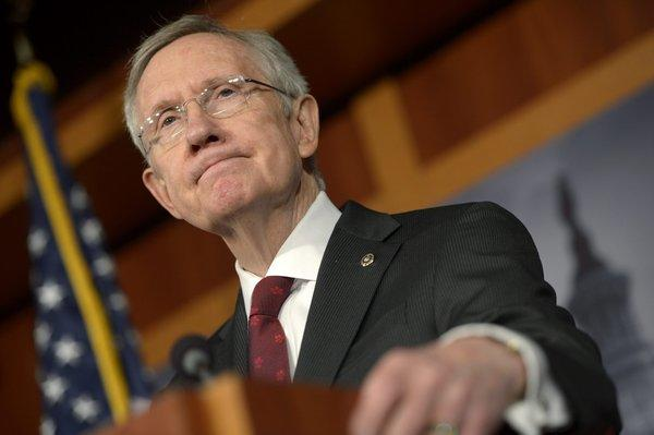 Sen. Harry Reid plans to introduce a bill that will include background checks and provisions on school safety and gun trafficking.