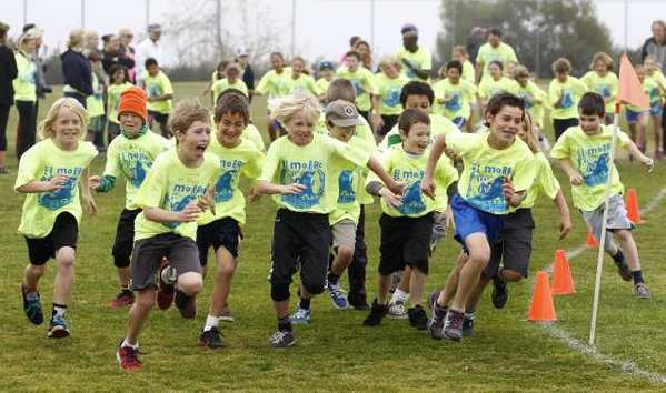 Fifth-graders take off from the starting line as they race to run as many laps as possible in the annual 2013 El Morro Jog-a-thon on March 15. The school's goal was to run 14,000 laps.