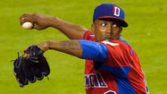 Reliever Pedro Strop, who threw 6 2/3 scoreless innings for the Dominican Republic's World Baseball Classic championship team, was back with the Orioles on Thursday, doling out hugs to teammates while grinning non-stop.