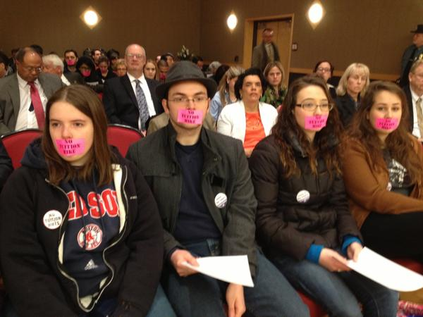 Students at a board of regents meeting protest a plan to increase tuition at state colleges and universities.