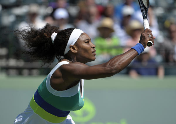 Serena Williams returns a forehand to Flavia Pennetta during their Sony Open tennis match, Thursday, March 21, 2013. Williams won 6-1, 6-1.