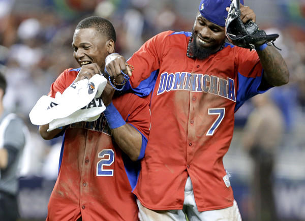 Dominican Republic shortstops Erick Aybar (2) and Jose Reyes (7) celebrate after a 3-1 victory over the U.S. in the second round of the World Baseball Classic.