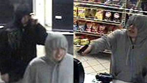 Surveillance photos of two men who robbed an Aurora store.