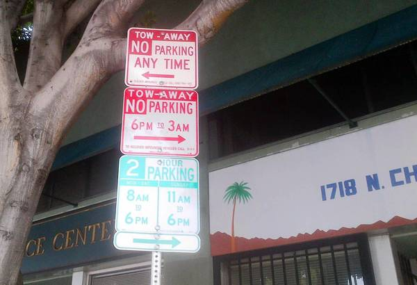 "Parking signs on Cherokee Avenue north of Hollywood Boulevard are complicated enough to defy even the most careful scrutiny. ""They're using the signs to confuse consumers,"" says Joshua Wattles, an attorney."