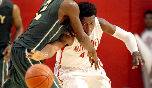 Mater Dei's Stanley Johnson knocks the ball away from Long Beach Poly's Jordan Bell in the first half of the CIF Southern California Open Division semifinal basketball playoff game.