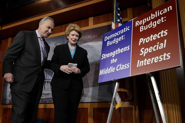 Democratic Senators Chuck Schumer, left, and Debbie Stabenow are seen at the conclusion of a news conference held by Senate Democrats on Capitol Hill.