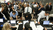 Applicants seeking work stand in line at the NEC Job Matching counter at the 10,000 Best Jobs Expo