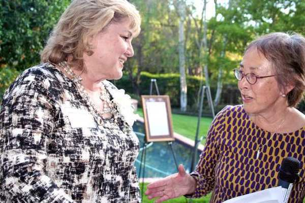 Pasadena resident Patricia DOrange-Martin is recognized as a 2013 Woman of the Year by Senator Carol Liu.