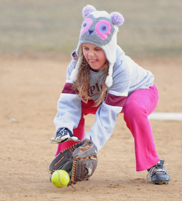 Mackenzie Laub, 9 and a memeber of the 10-under Egypt girls softball team, practices fielding at Stile Memorial Park in Whitehall on Thursday.