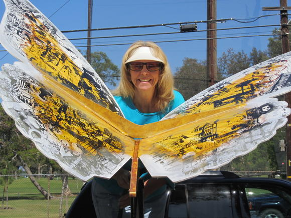 Artist Robin Repp with her butterfly sculpture. The metal sculpture was stolen from Gibbs Park last Saturday night.