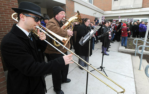 Allentown School District music teachers perform during the teachers rally prior to the Allentown School Board meeting at Trexler Middle School Thursday night. The Allentown School Board is considering a resolution to cut 150 teaching positions as part of a curtailment of programs.