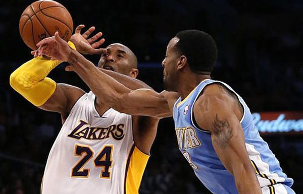 A playoff matchup between Kobe Bryant (24) and the Lakers against Andre Iguodala and the Nuggets would favor Denver, according to former Lakers great Jerry West.