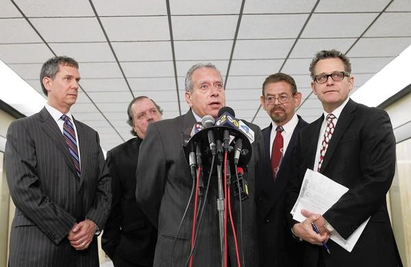 Defense attorneys and their clients speak at a news conference following the Bell trial at the courthouse in downtown Los Angeles. From left: Ronald Kaye, who represented George Cole; defendant Victor Bello; attorney Leo Moriarty, who represented Bello; defendant George Mirabal and attorney Alex Kessel, who represented Mirabal.