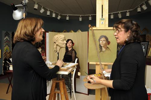 "Identical twin sisters and artists Susan (left) and Sandra (right) Wakeen held a dueling demo sculpting and painting a model, Maria Santana, (center)  at the Hartford Fine Art and Framing Gallery in East Hartford Thursday evening. The event coincides with an exhibition of their work at the gallery called ""The Allure of Oil and Bronze"" that will be on display through March 30."