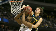 AUBURN HILLS, Mich. -- Glenn Robinson III scored 21 points and Mitch McGary finished with 13 points and nine rebounds, helping fourth-seeded Michigan overcome a rough night for Trey Burke in a 71-56 NCAA tournament win over 13th-seeded South Dakota State on Thursday night.